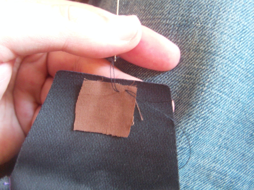 Begin to stitch the fabric to the bag