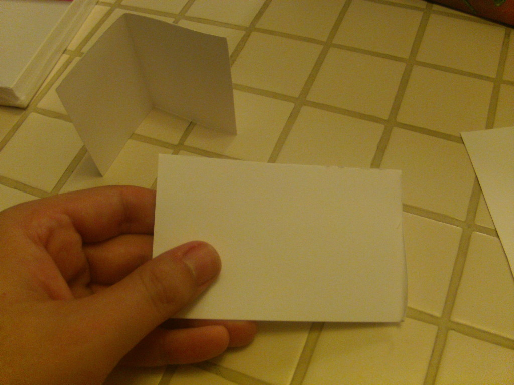 Now cut this strip into two equal lengths and carefully fold these lengths in half, making your new corners for your box