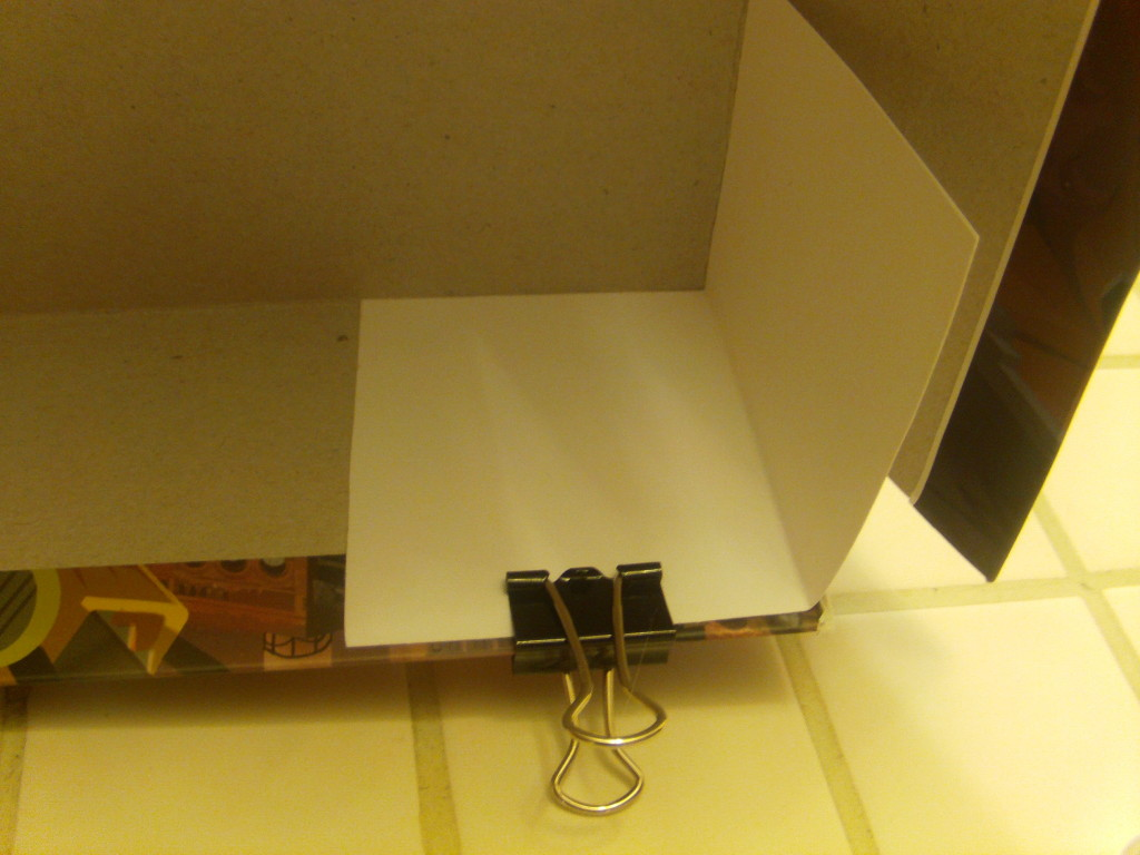 Secure this second corner in place with another binder clip. Notice how the glue doesn't bleed through in this picture?